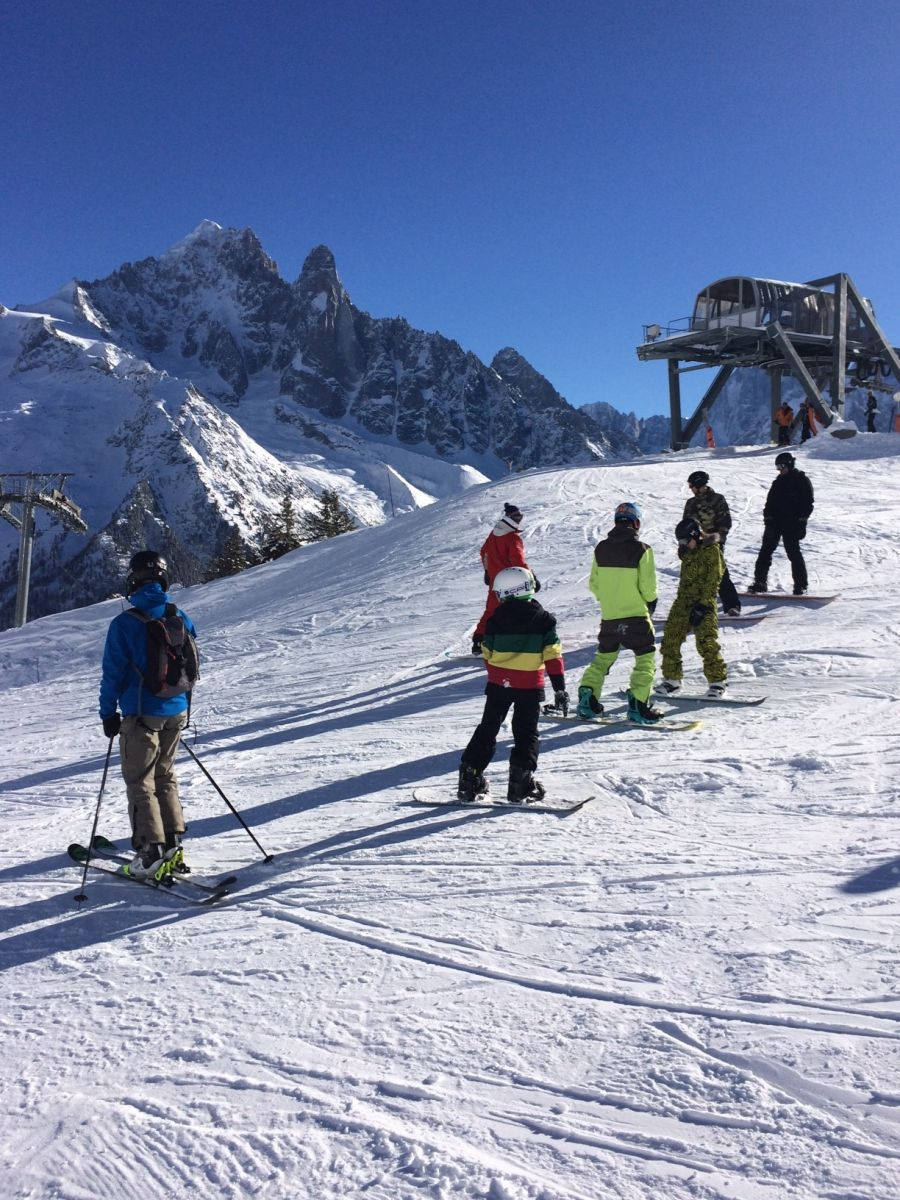 A great day for snowboard lessons today under the blue sky of Chamonix